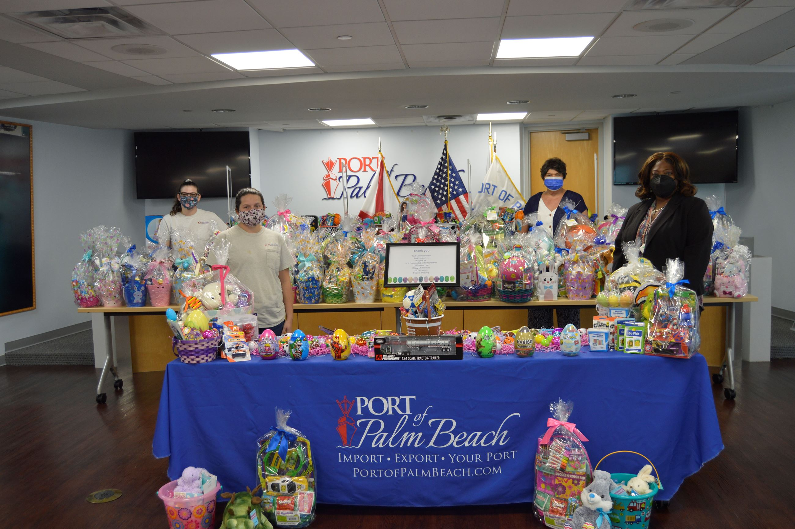 Port staff members and All Star Plumbing reps with more than 70 Easter baskets